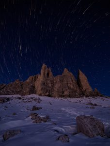 Long Exposure early morning starscape picture of the mountains and snow