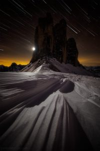 Long Exposure Starscape of the snow leading into the mountains