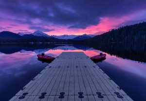 Auke Lake Surprise - Fiery sunrise over a boat dock in Juneau, Alaska