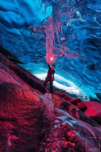Burn it Down - Red flare burning under a glacier