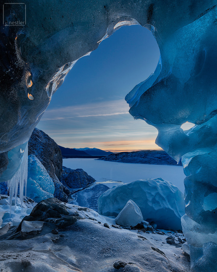 Door to Narnia - Sunset image from an ice cave under a glacier in Alaska