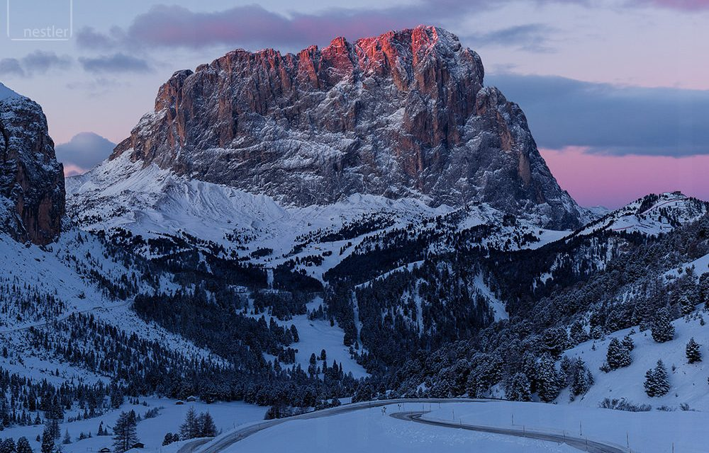 Pink hues highlight the Italian dolomites at sunrise in winter
