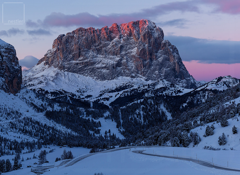 Pink hues highlight the Italian dolomites at first light in winter
