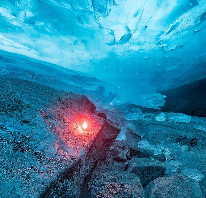 Fire and Ice - Red flare inside an ice cave in Juneau, Alaska