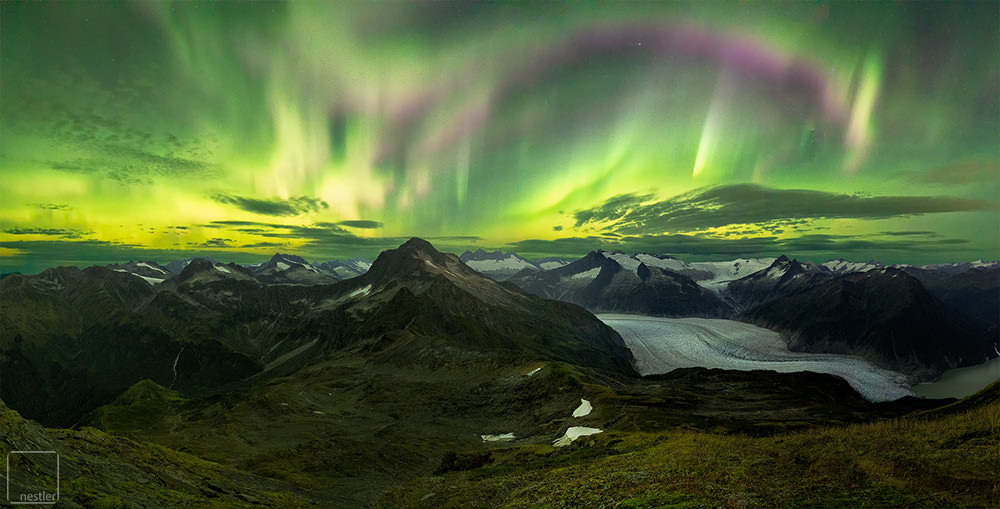 Glow - Northern Lights over the Mountains and Glacier of Alaska
