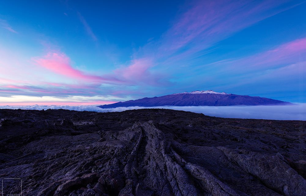Sunset from Mauna Loa looking toward Mauna Loa with pink clouds in the sky